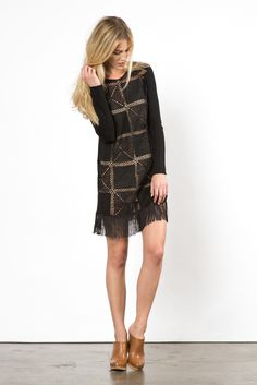 The 20s and 60s meet together in this awesome crocheted tassel long sleeved dress. With its crochet squares throughout the body, taupe colored lining and soft tasseling at the hem, its perfect for shimmying at your next party!