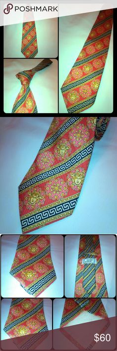 Vintage Gianni Versace silk tie Beautifully classic designed rare Gianni Versace 100% silk tie. Adorned with Medusa images & greek band throughout the tie. This tie is certainly making a statement! This rich salmon colored tie with classic gold & black Versace trim was made in Spain. Versace Accessories