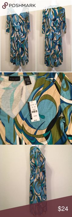 """NWT New York & Company Cyan Retro Print Dress Size L.  MSRP $57.  V-neck.  Pleated skirt.  Length shoulder to hem: 42.5"""".  Measurements laid flat – Bust: 38"""", Waist: 34, Hips: 50"""", Bottom of dress: 56"""".  Sleeve length: 16.6"""".  Cuff width: 4.5"""".  95% rayon, 5% spandex – soft jersey material with stretch, drapes well.  Machine wash cold, lay flat to dry.    Love it but not the price - I'm open to (reasonable) offers or consider bundling 2 or more items for an additional 15% off and combined…"""