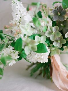 Hellebore, Lilac, honeysuckle, ranunculus, Queen Anne's Lace