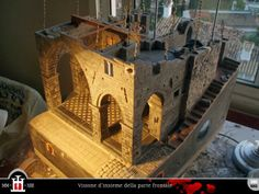 The Domus project is the construction in scale 1:50 of an imaginary medieval palace. It's made of clay, stones, slate, wood and other construction materials in the style of rich genoese buildings from the middle of XIV century.