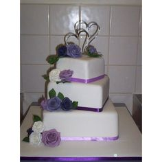 purple/lilac roses square 3 tier wedding cake - 2009 Wedding Cake Contest by mrsmaynshaft on CakeCentral.com found on Polyvore