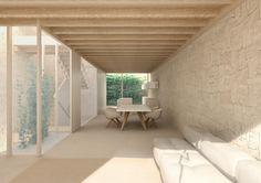 Interior de una casa de piedra y madera con patio