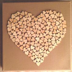 Zelfgemaakt! Canvas + houten decoratie hartjes.