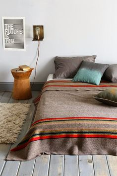simple woven blanket and whitewashed floors #onetawoodworks #rustic #reclaimedwood