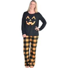 Cozy up in this set of Jack-o'-Lantern Pajamas! The sleep set comes with a black long-sleeve with a happy Jack-o'-Lantern face printed in orange in the center. Also included are a pair of black and orange plaid pants. Halloween Pajamas, Halloween Labels, Halloween Costume Shop, Family Halloween, Halloween Clothes, Halloween Goodies, Halloween 2020, Halloween Outfits, Holiday Outfits