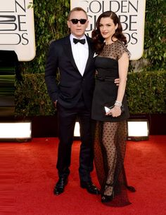 Lovely couple - Daniel Craig wearing a Tom Ford suit and wife Rachel Weisz in Louis Vuitton at the Golden Globes 2013