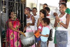 """The Day of the Angels in Cartagena, Colombia, is full of music and revelry. When neighbors give food for the sancocho soup, the kids will sing to the donor: """"Este casa es de arroz donde vive el Niño Dios!"""" """"This house is made of rice, [it  is] where Baby God (Jesus) lives!""""  Click image to read more."""