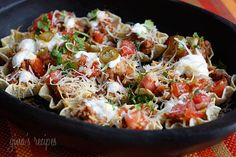 To celebrate Cinco De Mayo, or any day, enjoy these loaded nachos without the guilt.  We had these for dinner but this is also great for lunch or as an appetizer. This recipe was inspired by Rocco Dispirito's new book, Now Eat This. I made some adjustments to his original recipe and it was DELICIOUS. High in fiber and lower in fat than regular nachos, which would be about 22 points if you ate these out.     Skinny Loaded Nachos with Turkey, Beans and Cheese Gina's Weight Watcher Recipes…