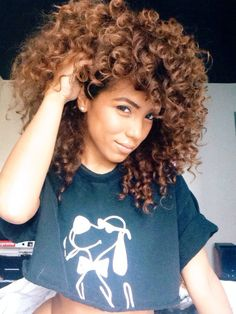 beautiful naturally curly hair. All that volume! All that colour!
