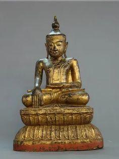 BIRMANIE, royaume d'Ava. Bouddha assis en bumisparsa. Teck laqué polychrome, trace de dorure. XVIIIe siècle. Hauteur : 62 cm.