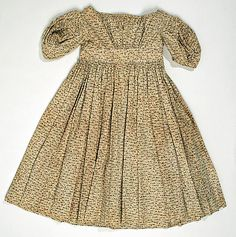 Ca. 1840, American, Cotton. Note the fan pleats rather than even pleats, as youd see in adult fashion. Round neckline too.
