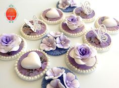 Purple vintage cupcake toppers with roses, flowers, hearts and butterflies for an Epilepsy fundraiser high tea.  Cakes from Bella Capella Culinary Delights in Capella, Queensland's Central Highlands, Australia. Contact: bellacapella@bigpond.com www.facebook.com/bellacapellaculinarydelights