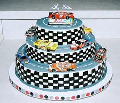 This cake was for my son's 10th birthday party.  He wanted something he could put his favorite Nascar cars on so I came up with this.  He loved it!  :0)