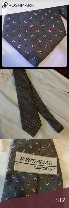 """Silk tie made in Italy This vintage Italian silk tie features classic styling.  It is about 3 1/16"""" wide and about 56"""" long.  Grey with small red paisleys and dots.  Labeled Northbriar Dayton's, a now defunct men's clothing line.  Excellent vintage condition. Vintage Accessories Ties"""