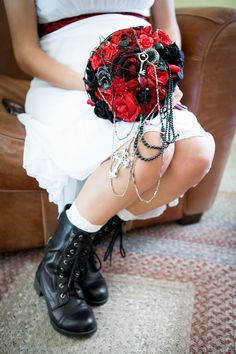 Not the colors I want, but I love the idea of having chains dangling from the bouquet. maybe chains and pearls?