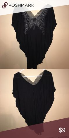 Women's black blouse with mesh butterfly on back Size M. Butterfly on back has shimmery silver woven in with it. Super cute on! And also very flattering! Tops Blouses