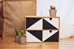 Black & White Moppe by The Life FactoryI love the way this relatively simple paint job has such graphic appeal—especially the way the drawer holes now appear to be part of the design. So smart!