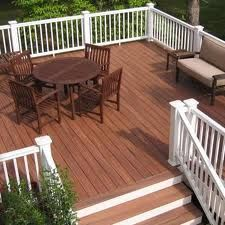 Wood deck with a white railing