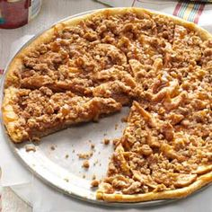 Apple Crisp Pizza Recipe -While visiting a Wisconsin apple orchard bakery, I tried this tempting treat. At home, I put together this Apple Crisp Pizza recipe. As it bakes, the enticing aroma fills my kitchen, and friends and family linger waiting for a sample. —Nancy Preussner, Delhi, Iowa