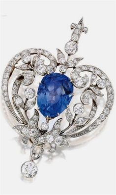 Platinum-Topped Gold, Sapphire and Diamond Pendant-Brooch, Marcus & Co. Centred by a pear-shaped sapphire weighing approximately 15.00 carats, within scrollwork surrounds set with old European-cut diamonds weighing approximately 4.50 carats, signed Marcus & Co., circa 1900. #diamondbroach #AntiqueJewelry