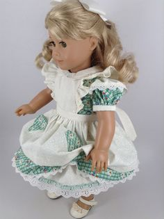 Handmade dress, pinafore, and petticoat for American Girl and other similar 18-inch dolls.  My dolly is wearing a 1940s-style floral cotton dress