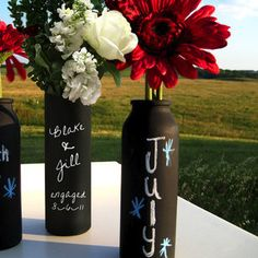 Chalkboard painted bottles as a centerpiece!!