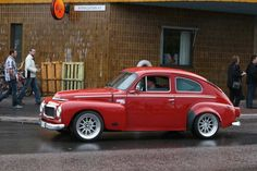 red 544 with flared fenders and custom wheels