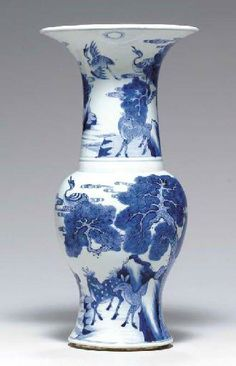 A blue and white yenyen vase, Kangxi period (1662-1722) © Christie's Image 2003 The body and trumpet neck vividly painted with...