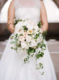 Do you like the greens here? Cascading Bouquets, Wedding Flowers Photos by Sylvie Gil Photography