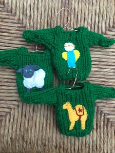 Handmade knitted Christmas story set or ornaments with angel, camel, and sheep from Purple Basset https://www.etsy.com/listing/484583221/knitted-xmas-ornaments-set-of-3-mini