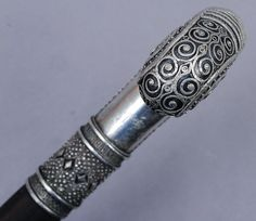 Lot: 354: SILVER FILIGREE MOUNTED EBONY WALKING CANE, Lot Number: 0354, Starting Bid: $100, Auctioneer: Auction Gallery of the Palm Beaches Inc., Auction: Major Spring Antiques and Fine Art Auction , Date: May 15th, 2012 AKDT