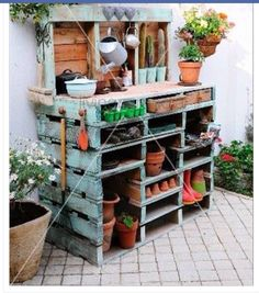 A gardening bench made out of wood pallets.
