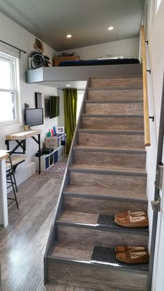 Tiny house with stairs and sleeping loft and cool storage system.