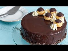 This Profiterole Cake is a rich decadent impressive dessert that will satisfy both chocolate and profiterole lovers. The cake is made with a moist cocoa brownie at the bottom, topped with chocolate mousse and cream cheese frosting filled profiteroles. Chocolate Cheese, Chocolate Glaze, Chocolate Recipes, Profiteroles, Cream Cheese Filling, Cream Cheese Frosting, Cocoa Brownies, Impressive Desserts, Kinds Of Desserts