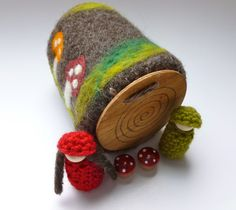 Felted wool log with peg dolls and mushrooms