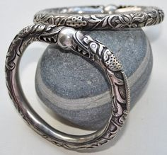 Stunning pair of Chinese silver wedding bracelets, featuring dragons capturing a pearl.  Ca. Qing dynasty.