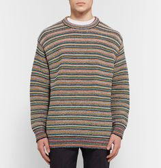 This Italian-made Stella McCartney sweater will be easier to wear than you think. Designed for an oversized fit, it's been impeccably knitted with touches of soft cotton and insulating wool in bold rainbow-hued stripes. Simply team it with slim black trousers.
