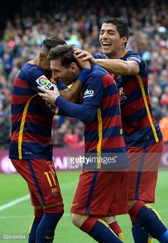 Barcelona's Argentinian forward Lionel Messi celebrates with Barcelona's Brazilian forward Neymar ans Barcelona's Uruguayan forward Luis Suarez after...