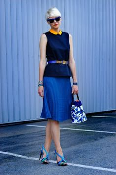 Italian-born-but-Paris-dwelling stylist Elisa Nalin is wearing a Cos top, Ventilo skirt, Mila Schon shoes, and Opening Ceremony sunglasses.