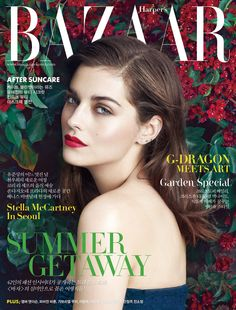 A/W15 campaign star Amber Anderson wearing Burberry make-up and a lace dress on the July cover of Harpers Bazaar Korea