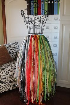 Organize craft ribbon with a wire dress form  (For my giant, organized craft room that only exists in my dreams...)