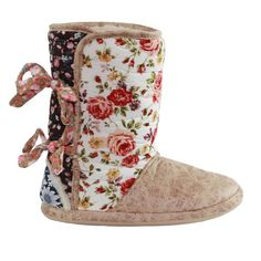 Tie into your senses with our newest, freshest boot. It's a garden of color & style with several distinctive prints all tied up in pretty floral ties. Don't hurry, don't worry and be sure to smell the flowers along the way.  *Cotton Floral Upper w/ Ties *Leatherette Foot *Faux Fur Lined *Indoor/Outdoor Soles  Sizes include: small (6 ½ - 7 ½) medium (8 - 8 ½) large (9 - 9 ½) xlarge (10 - 10 ½)