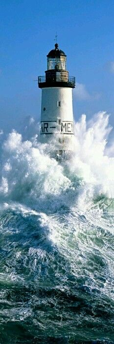Crashing waves around a lighthouse