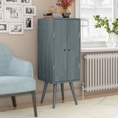 Carson Carrington Shorewood Mid Century Modern Vertical Wood Chest with Door (Grey Finish), Gray Wood Chest, Furniture, Modern Materials, Online Furniture Outlet, Solid Wood Chest, Family Room, Mid Century Modern Cabinets, Tall Cabinet Storage, Modern Cabinets