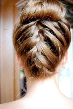 Surprise everyone with an upside-down braided bun - no one will see it coming!