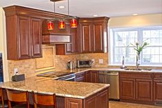 This Traditional Kitchen Is Economically Designed In Our Fabuwood Cabinet  Line. The Mitered Maple Doors With Cinnamon Stain And Chocolate Glaze Would  Add ...