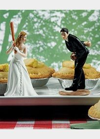 For all of those baseball sports fans, this is the cake topper that truly hits a home run!! The groom is about to throw the perfect pitch to his bride who is ready to swing! Groom measures 4.5 inches high. Base measure 2.25 inches. Bride (with baseball bat) measures 5 high. Base measures 2.5 inches. Groom cake topper weighs 4 ounces. Bride cake topper weighs 3.2 ounces. Cake toppers sold separately.