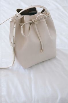 Get yourself a bucket bag for fall.