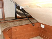 """$49  Bedlift Kit - Large. Large Bedlift kits are designed to lift standard King & Queen RV Beds with heavy mattresses.The kits come complete with all the hardware and two 20"""" x 120 lb gas springs for installing both sides of the RV bed. Oversize King mattresses and / or very heavy platforms may require stronger lifts."""